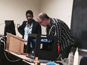 Sandra and Preston demonstrating the 3D printer.